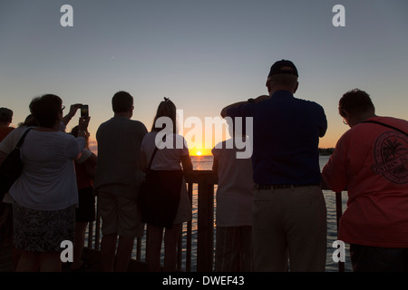Key West, Florida - Tourists gather in Mallory Square to watch the sunset. - Stock Photo