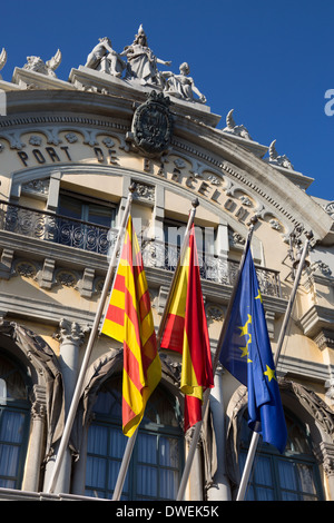 Port of Barcelona Building with flags of Catalonia, Spain and European Union - Barcelona, Spain. - Stock Photo