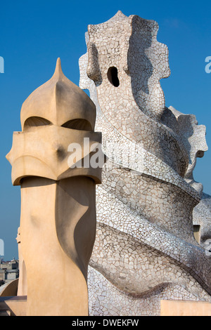 Ornate chimney designs on the roof of Gaudi's Casa Milia in the Eixample district of Barcelona in the Catalonia region of Spain.