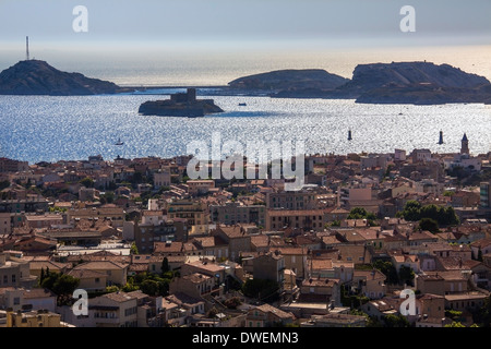 View over the city of Marseille to the Chateau d'If (Castle of Yew) - Cote d'Azur region of the South of France. - Stock Photo