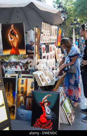 Tourists at a market stall on Las Ramblas in the city of Barcelona - Catalonia region of Spain - Stock Photo