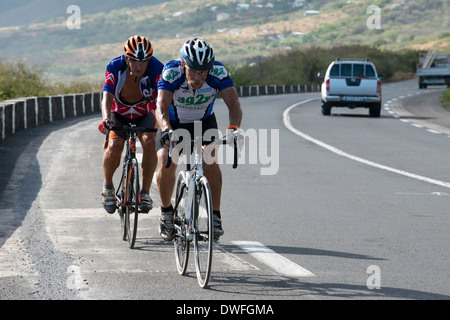 Cycling on the road.Mafate The Circus is one of the 3 major collapses oldest volcano on the island of Reunion. - Stock Photo