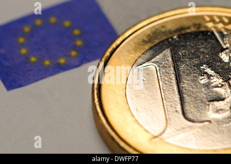 1 Euro coin on €5 Euro note - Stock Photo