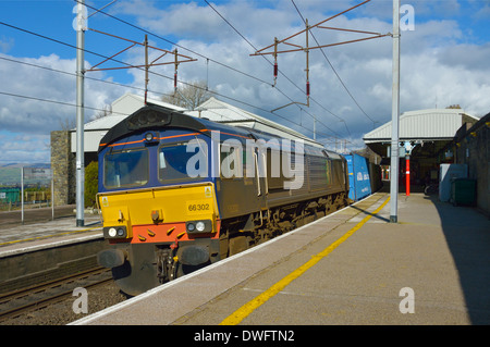 Direct Rail Services container freight train at Oxenholme, Cumbria, England, United Kingdom, Europe. - Stock Photo