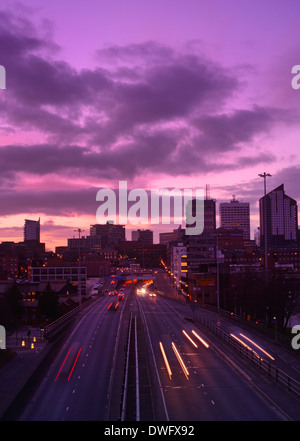 traffic trails of traffic heading too and from the city of leeds at sunset leeds yorkshire uk Stock Photo