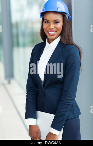 professional African female architect holding laptop computer - Stock Photo