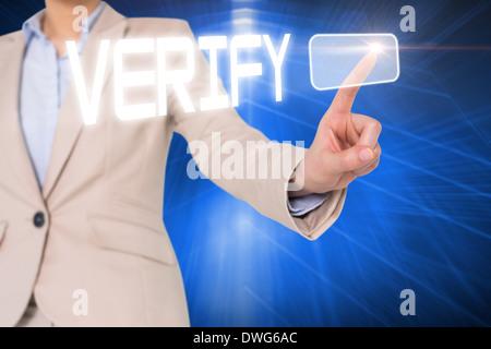 Businesswomans finger touching verify button - Stock Photo