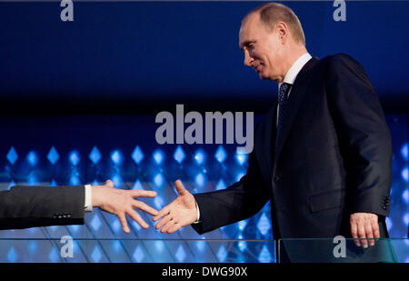 Sochi, Russia. 07th Mar, 2014. Russian President Vladimir Putin shakes hands during the Opening Ceremony in Fisht - Stock Photo