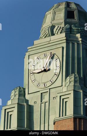 The clock of Helsinki Central Railway Station in morning sunlight. - Stock Photo