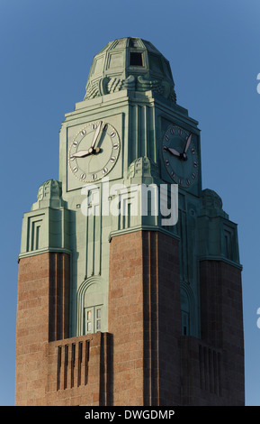 The clock-tower of Helsinki Central Railway Station in morning sunlight. - Stock Photo