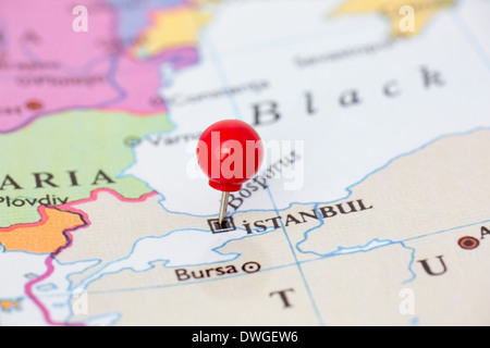 Round red thumb tack pinched through city of Istanbul on Turkey map. Part of collection covering all major capitals - Stock Photo