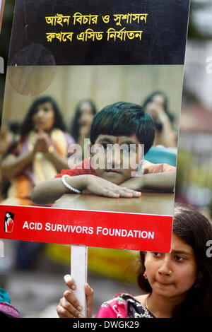 Dhaka, Bangladesh, 07th March 2014: Survivors of acid attacks, attend a human chain to protest against acid violence - Stock Photo