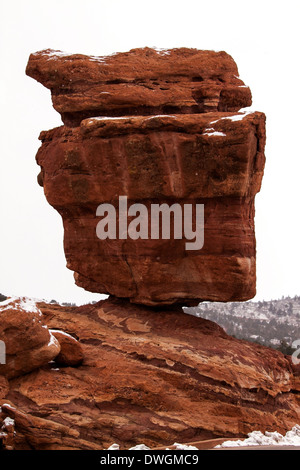 Balanced Rock in Garden of the Gods Park on a snowy day - Stock Photo