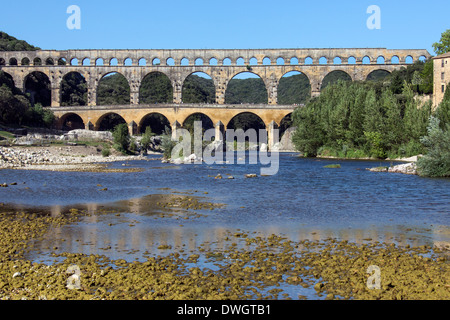 Pont du Gard Roman Aqueduct over the Gardon River near Remoulins in the South of France - Stock Photo