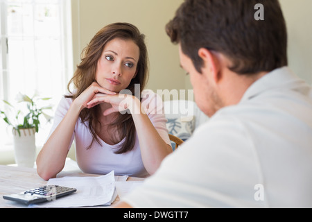 Young couple with home bills at table - Stock Photo