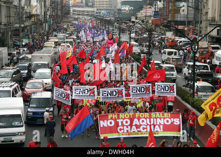 Manila, Philippines - 8th March 2014: International Women's Day participants marching through Quezon Boulevard in - Stock Photo