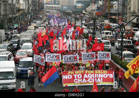 Manila, Philippines. 8th Mar, 2014. International Women's Day participants marching through Quezon Boulevard in - Stock Photo