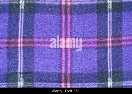 Close up of a purple tartan blanket - Stock Photo