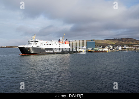 Caledonian MacBrayne car and passenger ferry Finlaggan arriving at ferry terminal Port Ellen on Islay Western Isles - Stock Photo