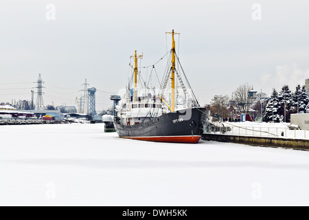 Average fishing trawler, bound with ice. Kaliningrad (until 1946 Koenigsberg), Russia - Stock Photo