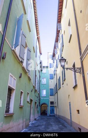 Colorful and narrow street in Reggio Emilia, Emilia Romagna, Italy - Stock Photo