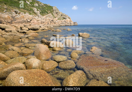 Round boulders cover the cove bed on a sunny summer day at Penberth Cove, Cornwall, England - Stock Photo