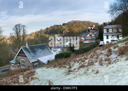 Sun rises over the Malvern Hills at the Wyche Cutting in Winter with the light brightening up Summer Hill. - Stock Photo
