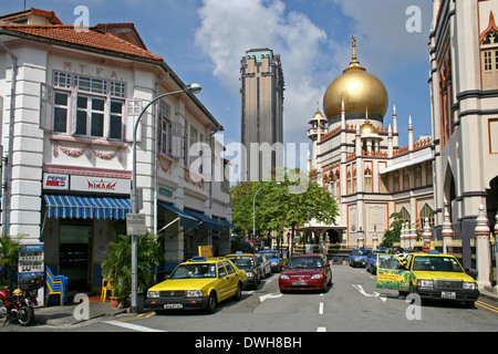 View of the Sultan Mosque in Kampong Glam with Parkview Square in the background - Stock Photo