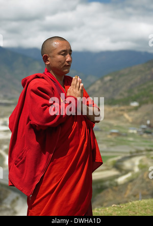 A Buddhist monk near Paro Dzong in the Kingdom of Bhutan. - Stock Photo