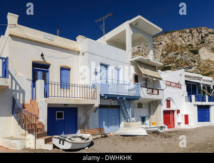 Syrmata, fishermen's houses in the tiny seaside village of Klima on Milos Island, Cyclades, Greece - Stock Photo