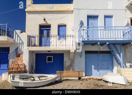 Syrmata, fishermen's houses in the tiny seaside village of Klima on Milos Island, Cyclades, Greece - Stock Photo