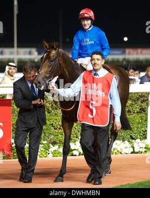 Dubai, UAE. 8th March, 2014. Excellent Result and Kieren Fallon arrive back in the parade ring after victory in - Stock Photo