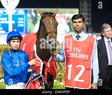Dubai, UAE. 8th March, 2014. Shuruq and Mickael Barzalona after winning race 5 the Burj Nahaar during Super Saturday - Stock Photo