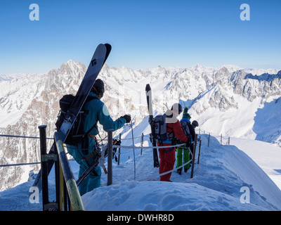 Skiers descending roped path route on arête to ski Vallee Blanche from Aiguille du Midi Chamonix-Mont-Blanc Rhone - Stock Photo