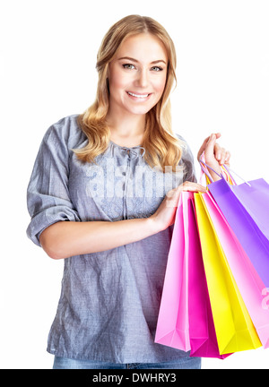 Happy shopper girl with four colorful paper bags isolated on white background, doing purchase, sale and spending - Stock Photo