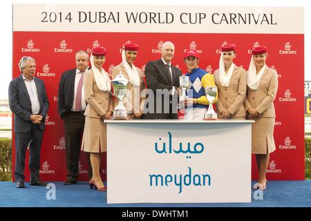 Dubai, UAE. 8th March, 2014. Christophe Soumillon collects his trophy after riding Shea Shea to victory in the Meydan - Stock Photo
