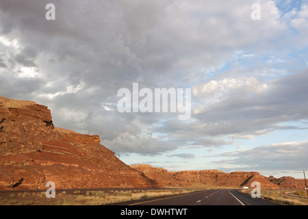 Driving on a Interstate Route 40 US Route 180 former Route 66 in the desert of Arizona United States with storm - Stock Photo