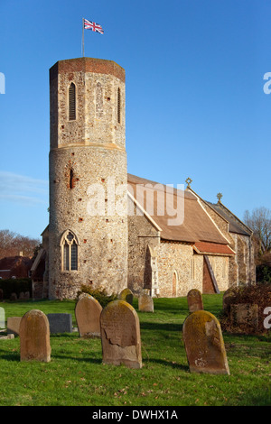 A rare example of a Round Tower Thatched Church. This St Mary's Church in the small village of West Somerton in - Stock Photo