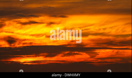Fiery sunset over Cardigan Bay - Stock Photo