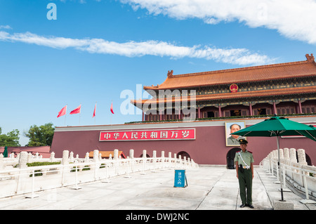 A Chinese officer stands guard outside of Tiananmen Gate in Beijing, China. - Stock Photo