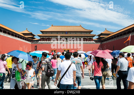 Tourists enter through the Meridian Gate into the Forbidden City in Beijing, China. - Stock Photo
