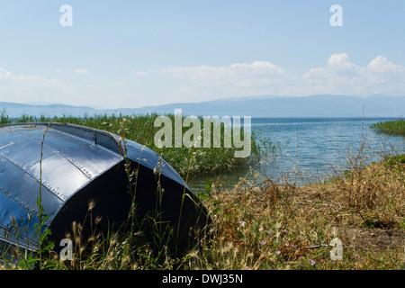 Small boat on the shore of Lake Ohrid, Macedonia - Stock Photo