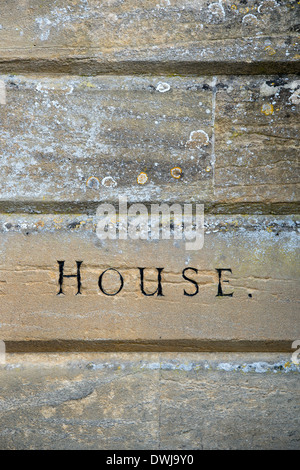The word house carved into cotswold stone in Burford, Cotswolds, Oxfordshire, England - Stock Photo