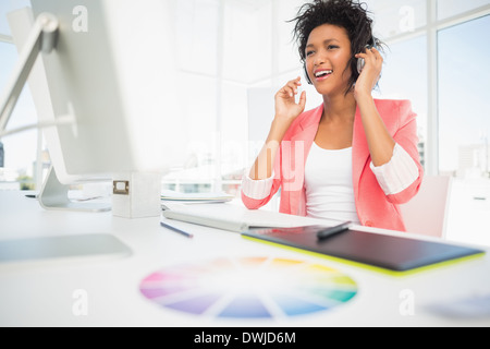 Casual female photo editor using computer - Stock Photo