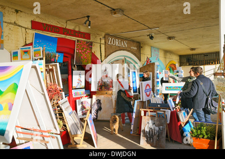 Art for sale outside galleries in The Artists Quarter on Brighton seafront, East Sussex, UK - Stock Photo