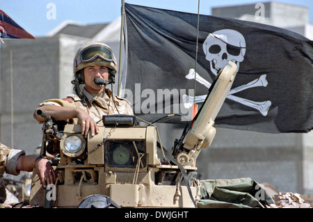 A British army soldier displays a Jolly Rogers pirate flag from his Ferret armoured scout car during the Persian - Stock Photo