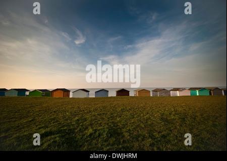 Beach huts overlooking the North Sea at Tankerton near Whitstable, Kent, UK - Stock Photo