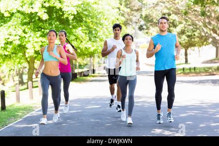 Marathon athletes running on street - Stock Photo