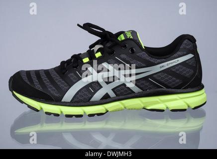Black and neon green Asics Gel Zaraca 2 running shoe - Stock Photo