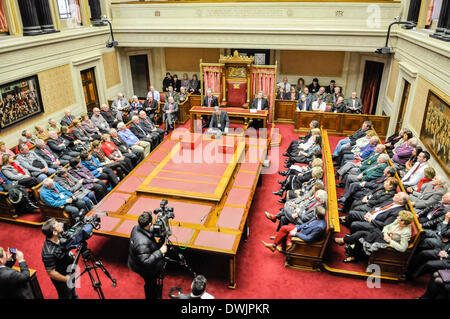 Belfast, Northern Ireland. 10 Mar 2014 - Invited guests pack the Senate Chamber to remember Victims of the Troubles. - Stock Photo